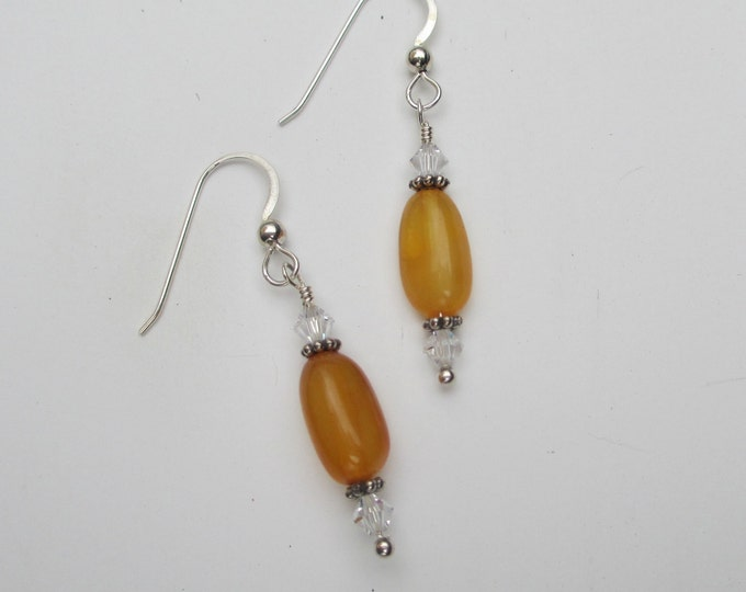 handmade honey amber earrings with clear Swarovski crystals sterling silver spacer beads and sterling silver ear wires