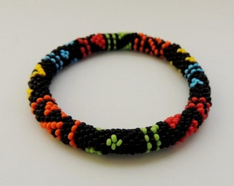 Roll On African style bracelet - Patchwork Geometric Bracelet - Black,salad bowl,orange,red,yellow,blue - Beaded crochet rope
