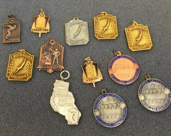 Lot of 12, vintage swimmng medals for jewelry making
