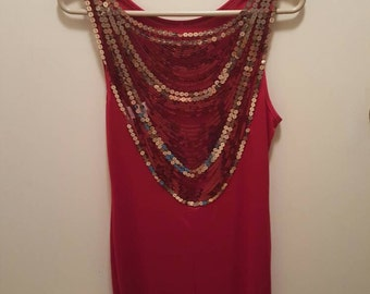Gorgeous red evening dress with detail on back.