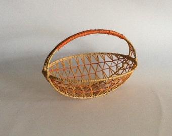 Woven raffia basket, tan with orange, metal wire wrapped with raffia