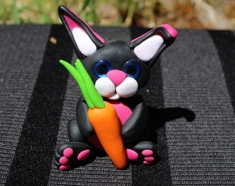 Black bunny with carot