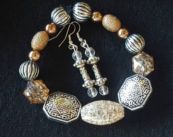 Fun stone and silver bracelet combo with earrings to match. Bracelet is stretch band and fits most wrists.
