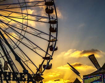 Ferris Wheel Against Setting Sun
