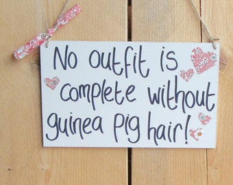 Hanging Wooden Saying Sign 'No outfit is complete without guinea pig hair'