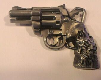 Pistol with Skull Belt Buckle