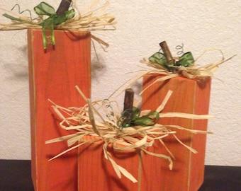 Wooden pumpkin trio