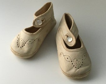 Vintage baby shoes, soft white leather, perforated decoration