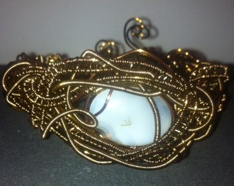 Wire wrapped cuff