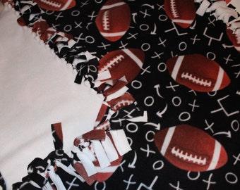 Football knotted fleece blanket.