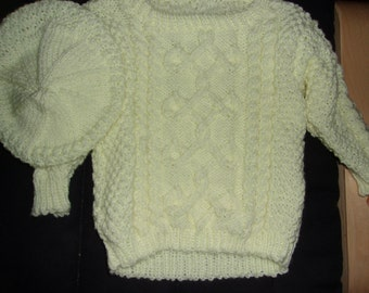 Cabled pullover sweater with hat