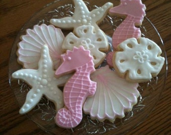 1 dozen sea creature cookies with clams, seahorses, sand dollars, and starfish