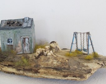 Derelict cottage with swing