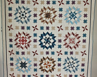 """Traditional 'Plain & Fancy' homemade quilt. 82""""x82"""" in size. Pinwheel and Star design, plus more. Floral patterned fabric. SHIPS FREE!"""