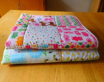 pram quilt/play mat in pink geometric and animal fabric
