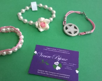 Trio of pink bracelets, pearls, crystals, flowers and stars