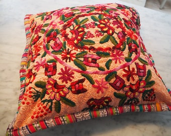 embroidered brightly coloured cushion cover