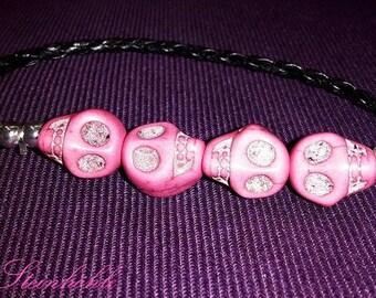 Bracelet pink rocking skulls