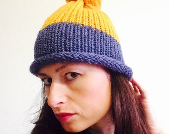 Hand knitted blue and yellow pompom beanie