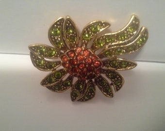 Pretty green and red rhinestone pin