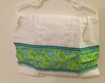 burp cloth with a green flower pattern