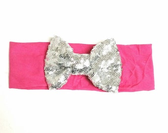 Hot pink with silver sparkly bow.