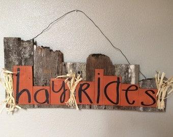 "Rustic ""hay rides"" sign"