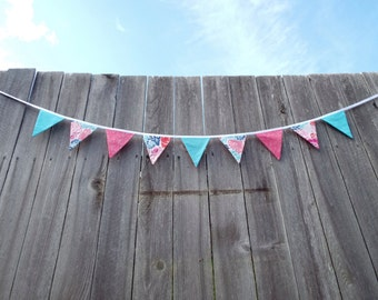 Colorful floral double-sided fabric bunting with reversible center flag