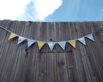 Blue, yellow, and grey raincloud fabric bunting