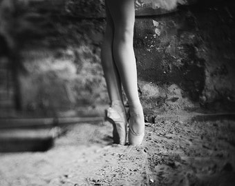 Point shoes between shadows. Fine art photography.