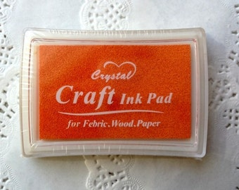 A case of ink for stamps colour orange 6 x 3.7 cm