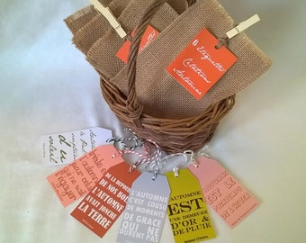 6 labels quotes about autumn in a jute bag