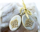 Oval tree of life porcelain pendants yellow and clear glazes