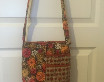 Brown and orange cross body bag.