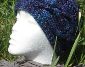 Blue bonnet at night with cables knitted hand