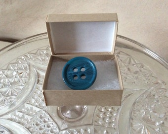 Cute as button blue brooch