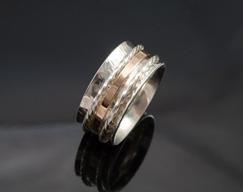 Hand Made Sterling Silver Spinning Ring with a 9ct gold centre Spinner