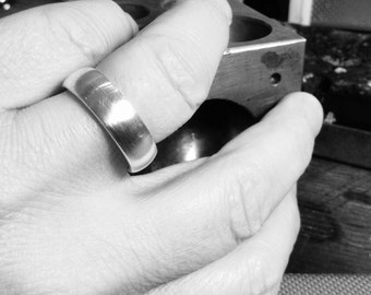 Smooth silver ring from our own workshop. 925 Silver, solid work.