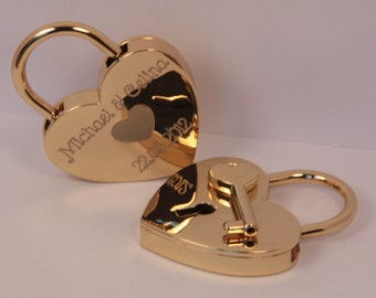 Love lock golden heart with engraving