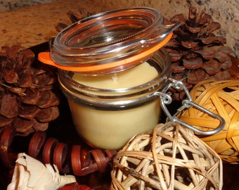 100% beeswax 6 oz scented candle in a swing-top lid jar.