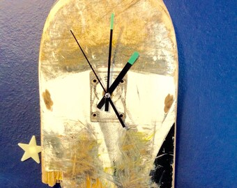 Thrashed skateboard clock