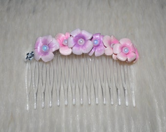 Elegant floral hair comb. Perfect for special occasions or just dressing up your little princess.