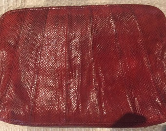 Snakeskin clutch, pink in colour