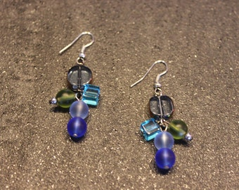 Earrings with clear and matte glass ball.