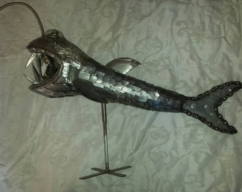 Caves fish sculpture from metal