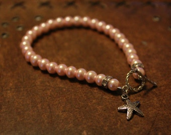 Pink pearl bracelet with starfish charm