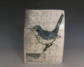 Soda fired blue birdie wall hanging