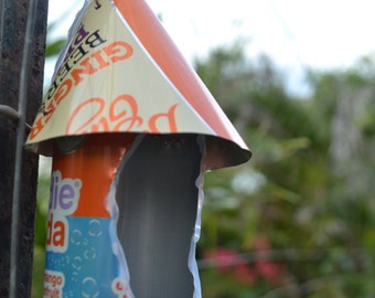 Recycled orange and blue soft drink can birdhouse