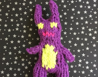 Hand knit catnip filled purple bunny