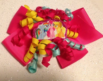 Disneys My Little Pony curled ribbon bow with Pink bow in background
